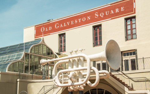 trumpet sculpture in front of Old Galveston Square