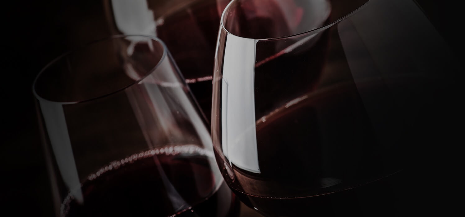closeup of red wine glasses