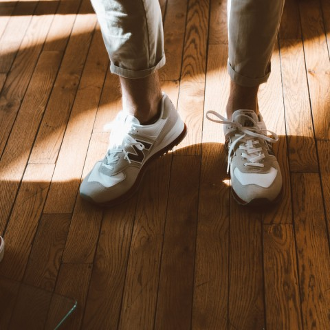 men standing on wood floors