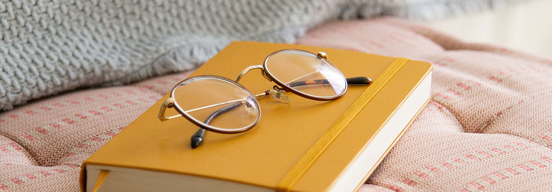 close up image of glasses on top of a book