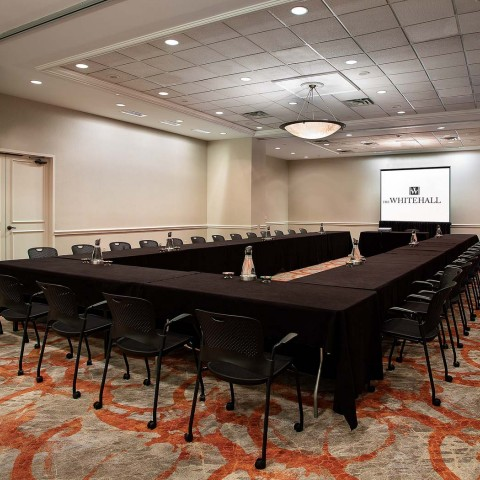 a U table in a board room with video beam