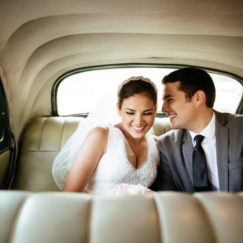 husband and wife smiling in the car