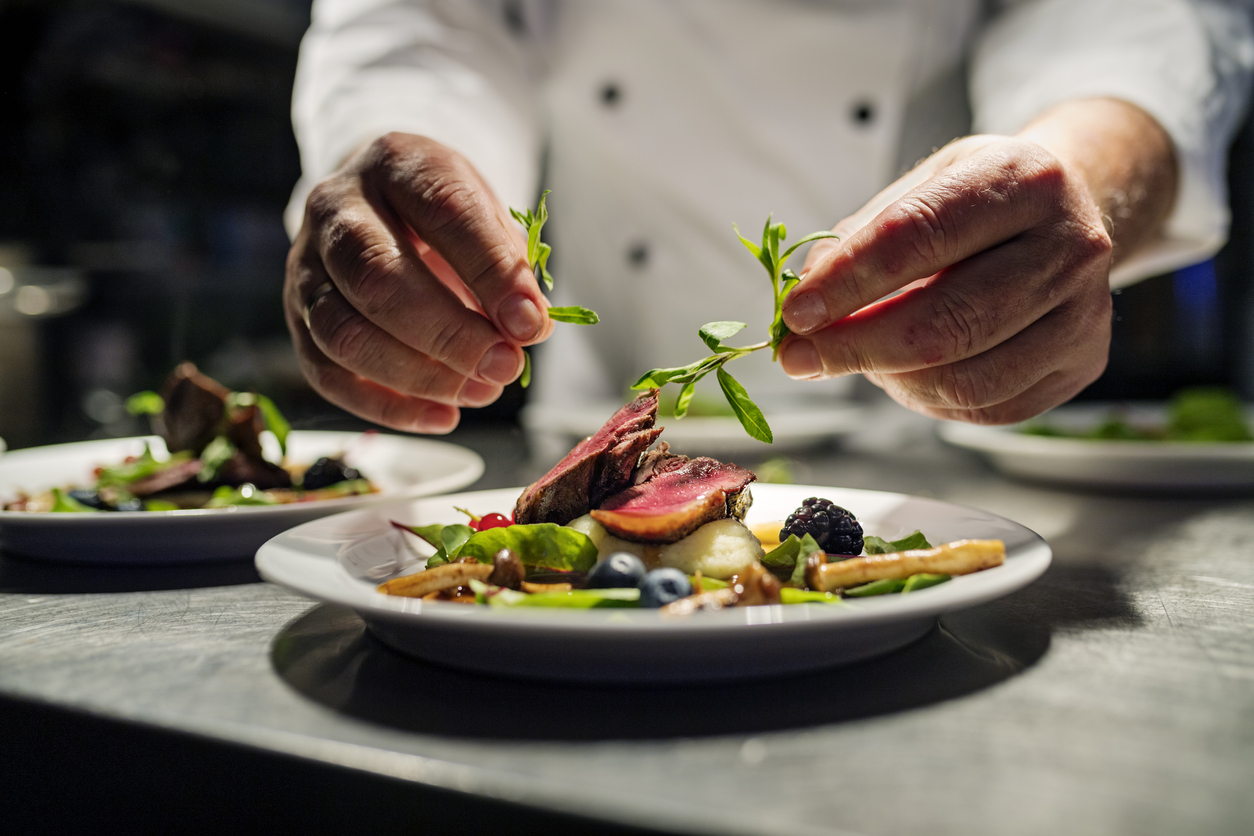 chef placing garnish on dish