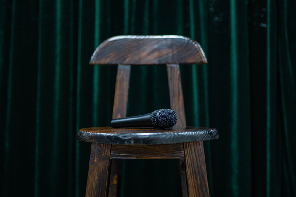microphone on a bar stool for standup comedy open mic night