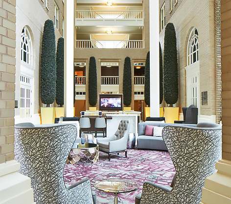 hotel lobby with chairs and tables