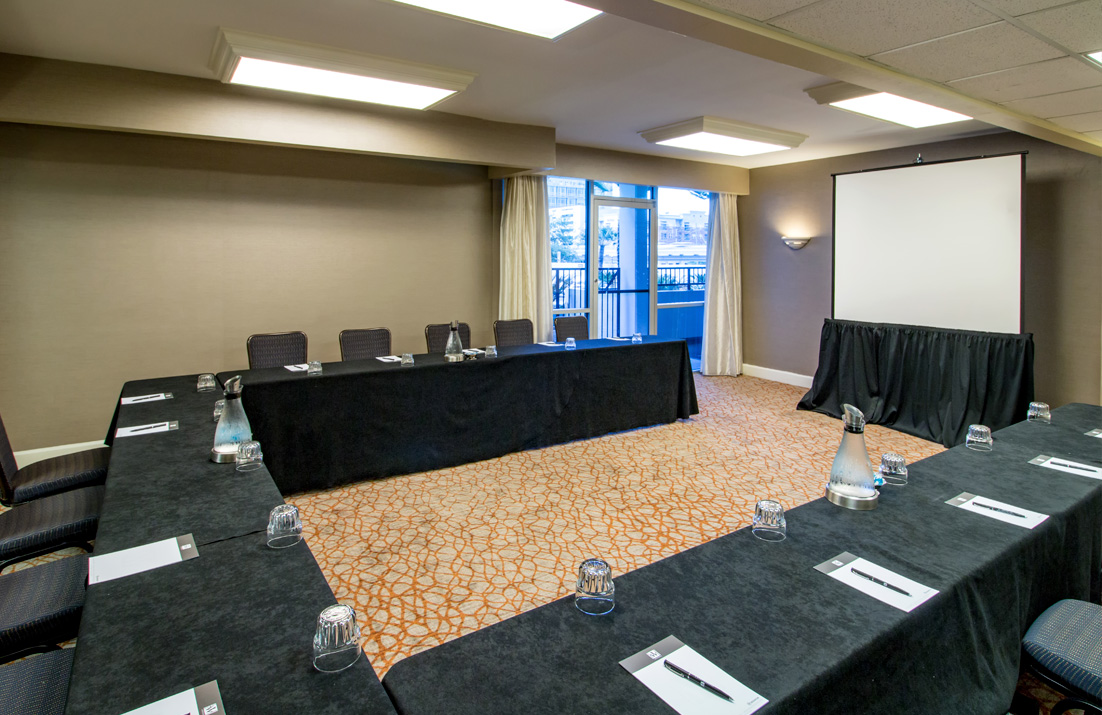meeting space with chairs in U position and projector