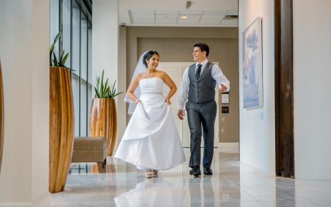 bridge and groom walking through hotel