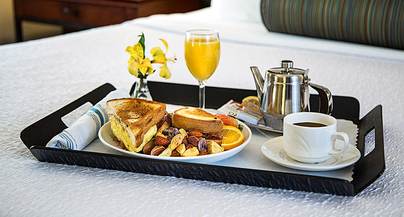 room service breakfast tray on the bed