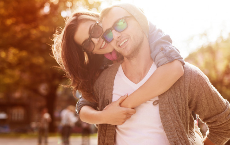 couple in the fall with sunglasses