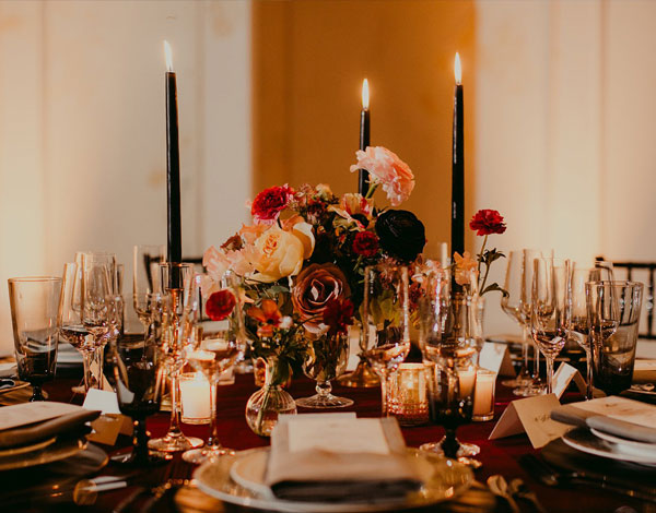 table set up with candles and flowers