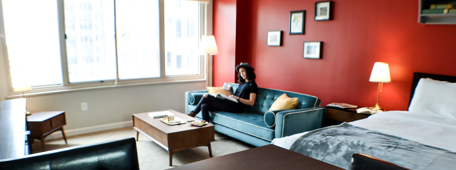 woman sitting on a couch inside a suite