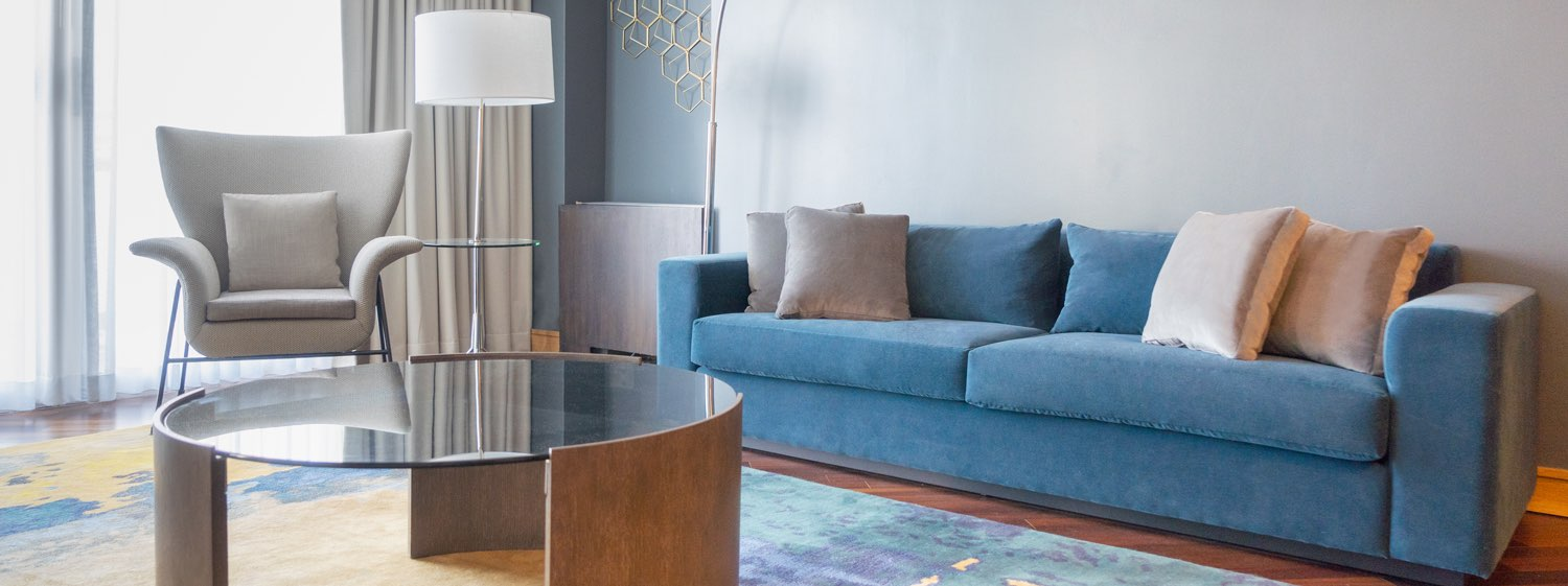 teal couch, table and lamp