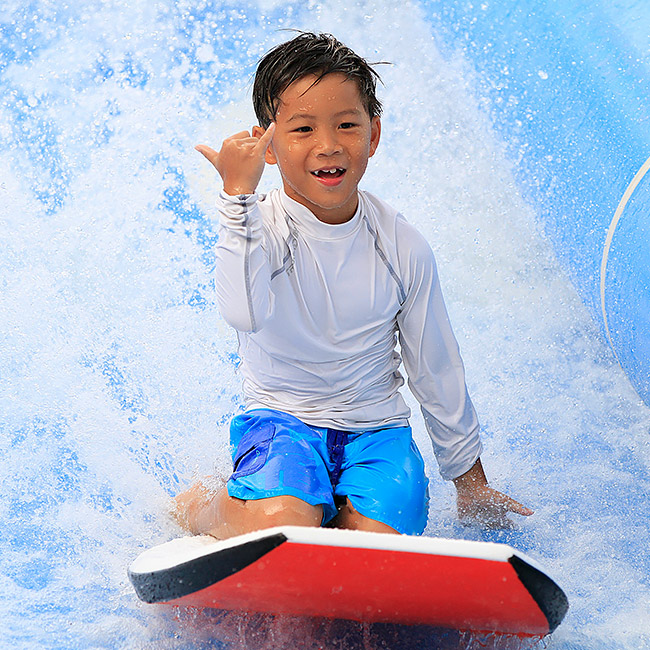 kid riding surfboard