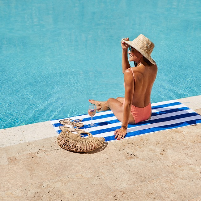 woman sunbathing over the pool