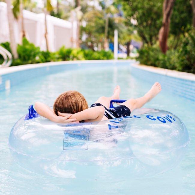 child riding the lazy river