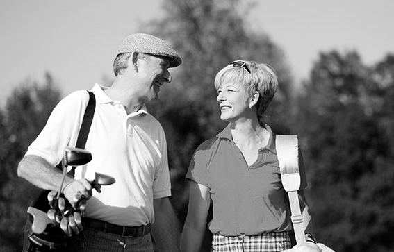 black and white picture of older couple golfing header