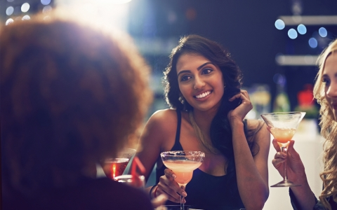 Women drinking cocktails