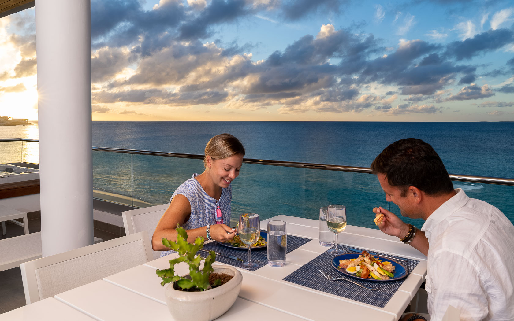 couple eating dinner on balcony with ocean views