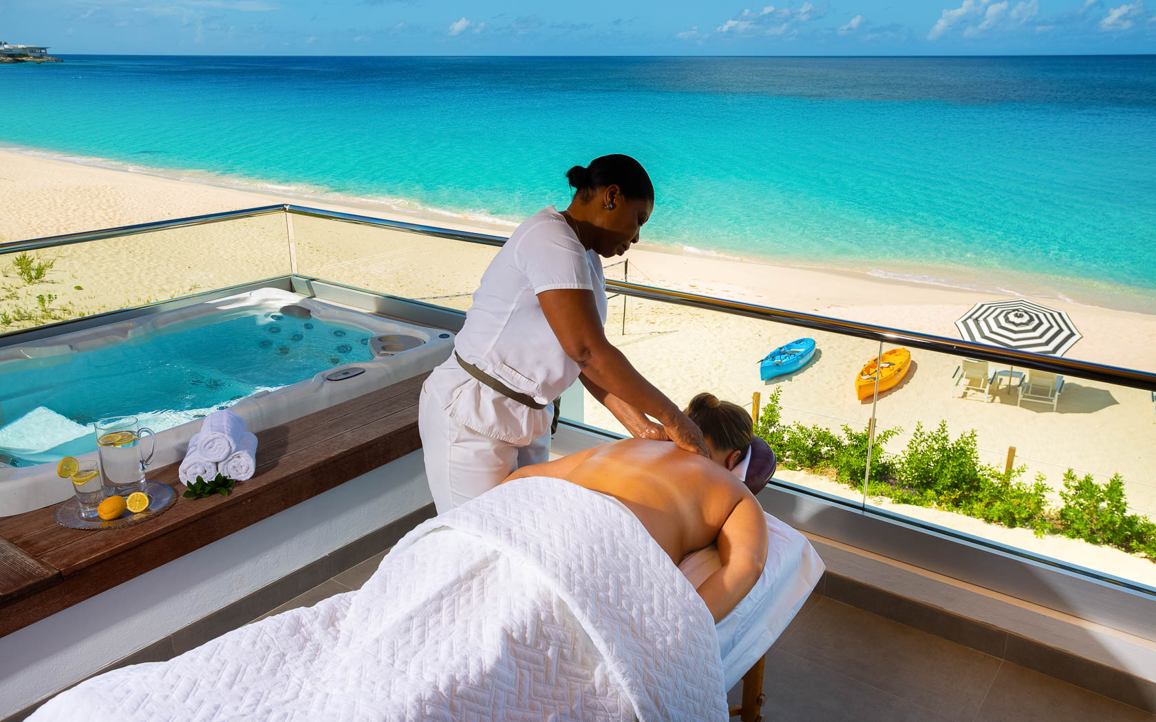 woman receiving professional massage on room balcony