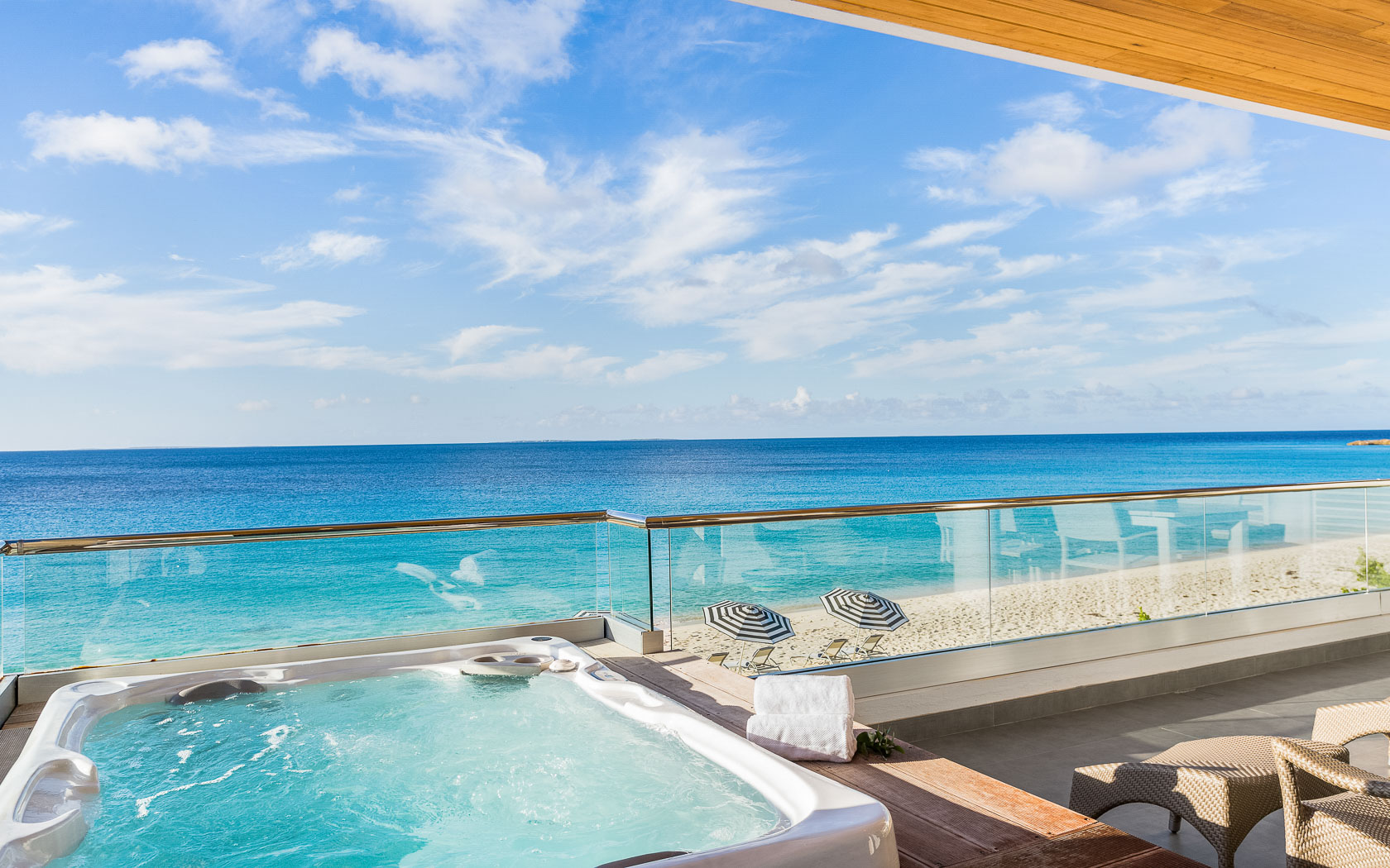 hot tub on room balcony that overlooks ocean