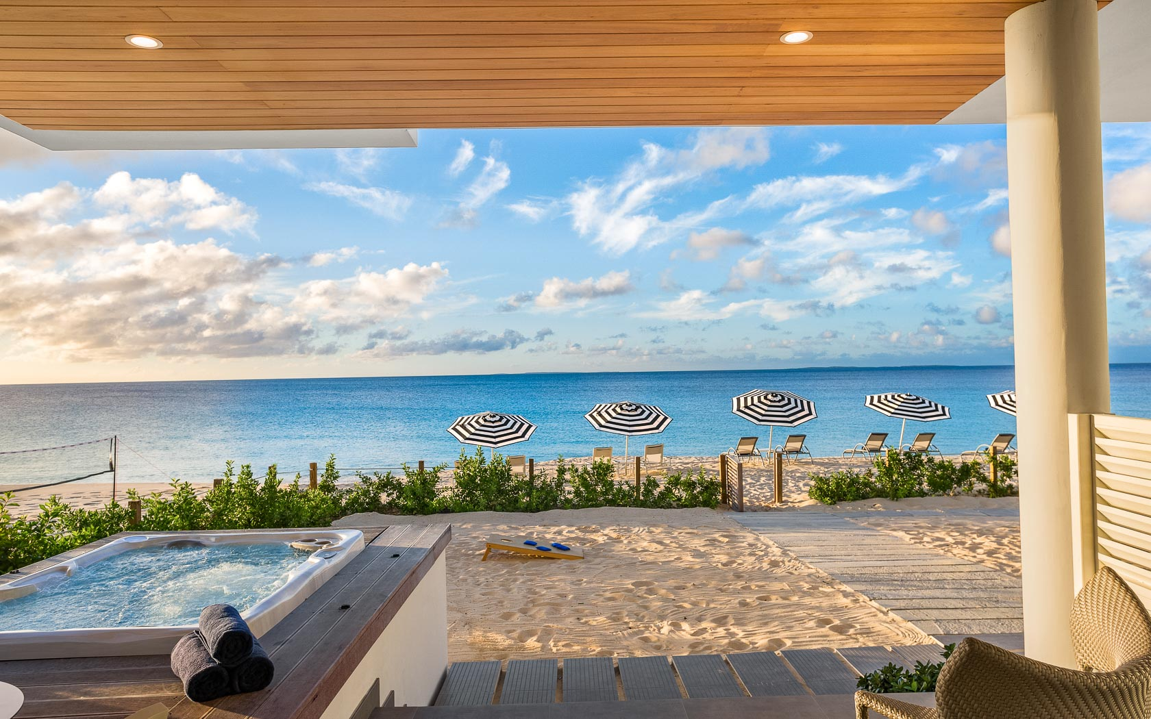 first floor patio view of beach with turquoise waters