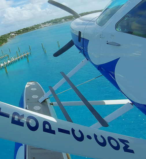 A closeup of a sea plane heading towards a dock