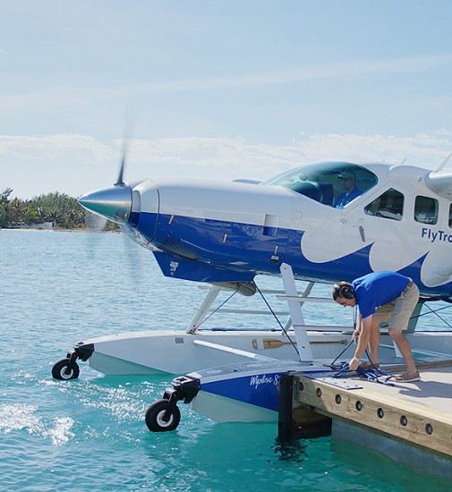 A man working on a docked sea plane