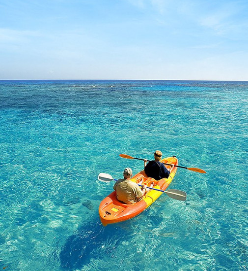 Two people on a kayak in the Bimini waters