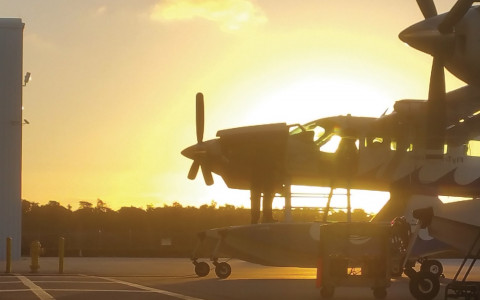 A dawn image of a sea plane on a runway