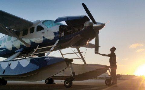 A man checks the propeller of a sea plane
