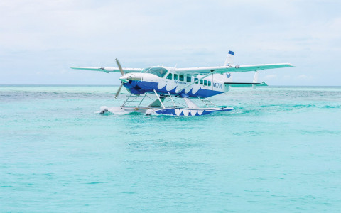 A sea plane sits on the open water