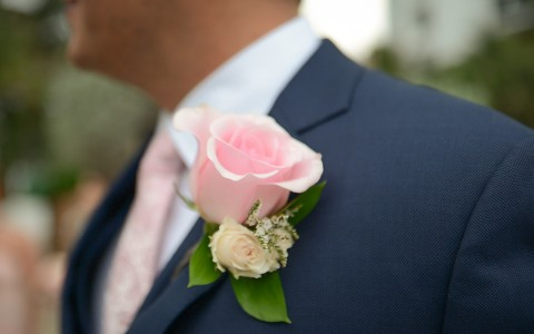 Pink rose on suit