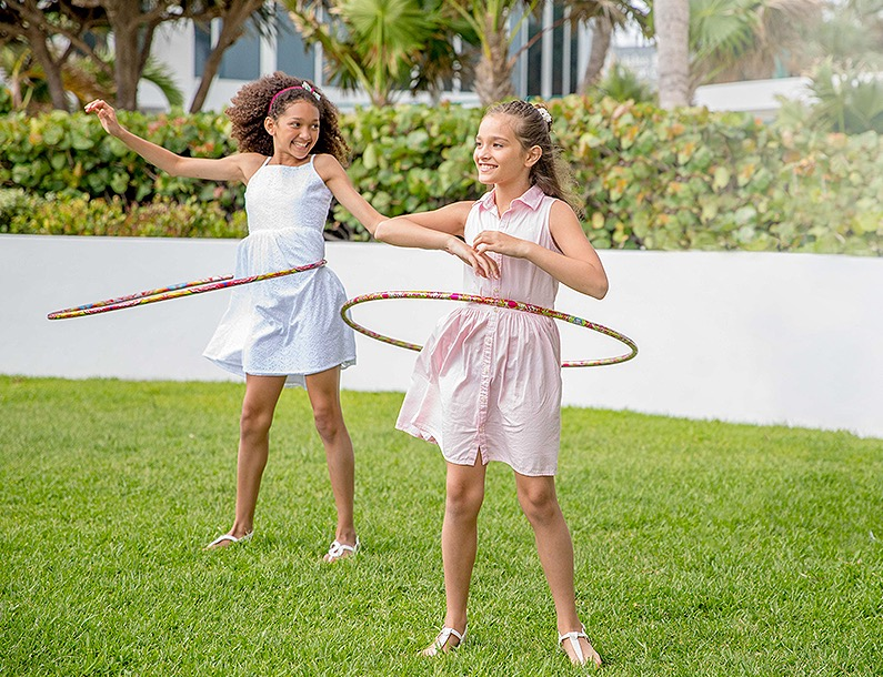 two girls hoola hooping