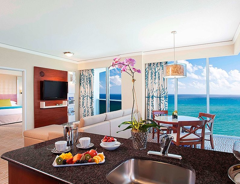 suite with full kitchen and living room suite looking at the ocean