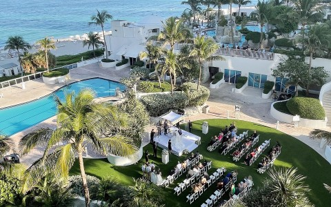 wedding ceremony on the lawn with view of the ocean