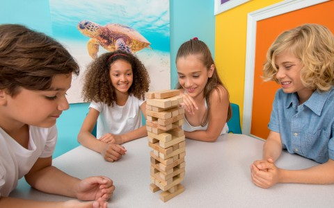 group of kids playing jenga