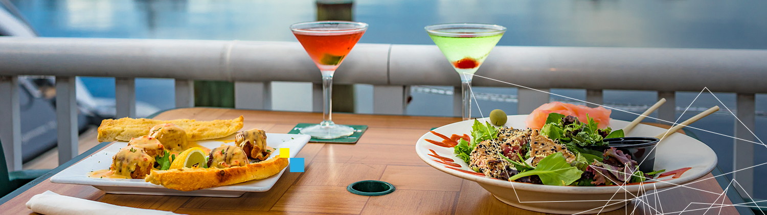 Two dishes on table with vibrant martinis