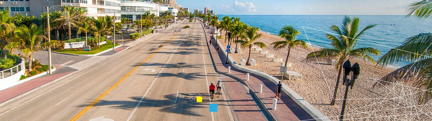 Fort Lauderdale beach with bicyclist