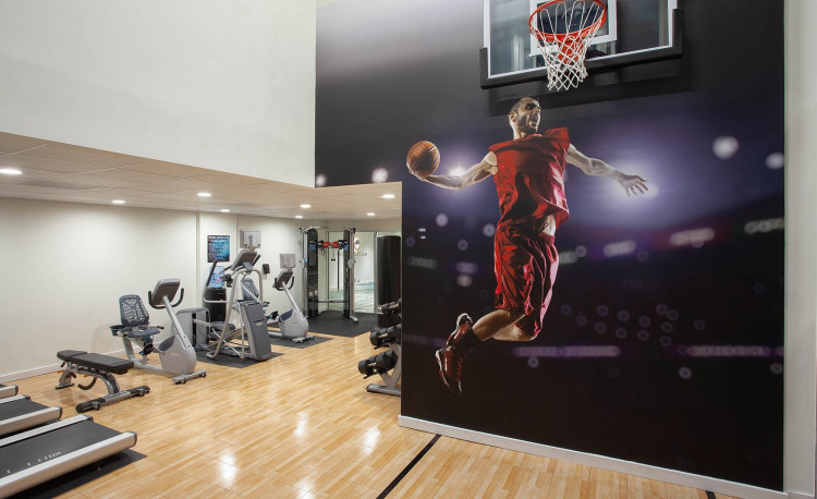 Fitness Center with work out equipment and basketball couty