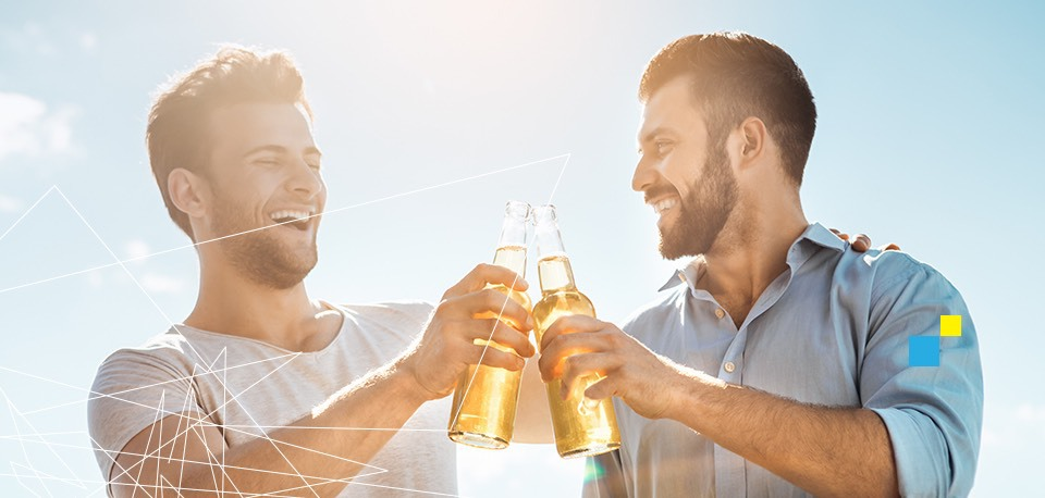Cheerful men clinking beers