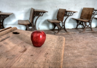 schoolhouse with apple on desk