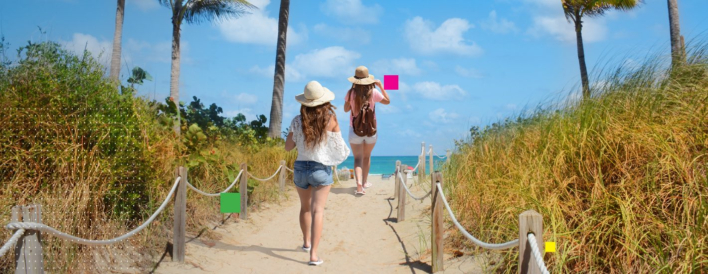 Two girls walking to the beach