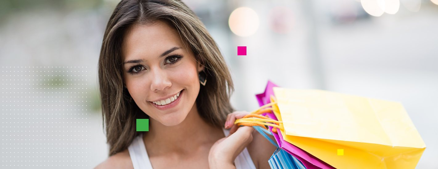Woman holding shopping bags smiling