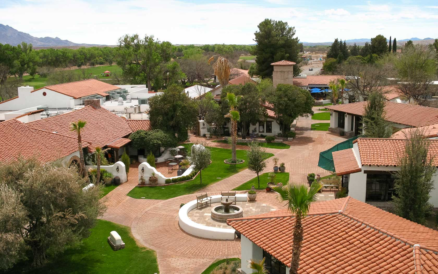 aerial view of property buildings with a fountain in the center