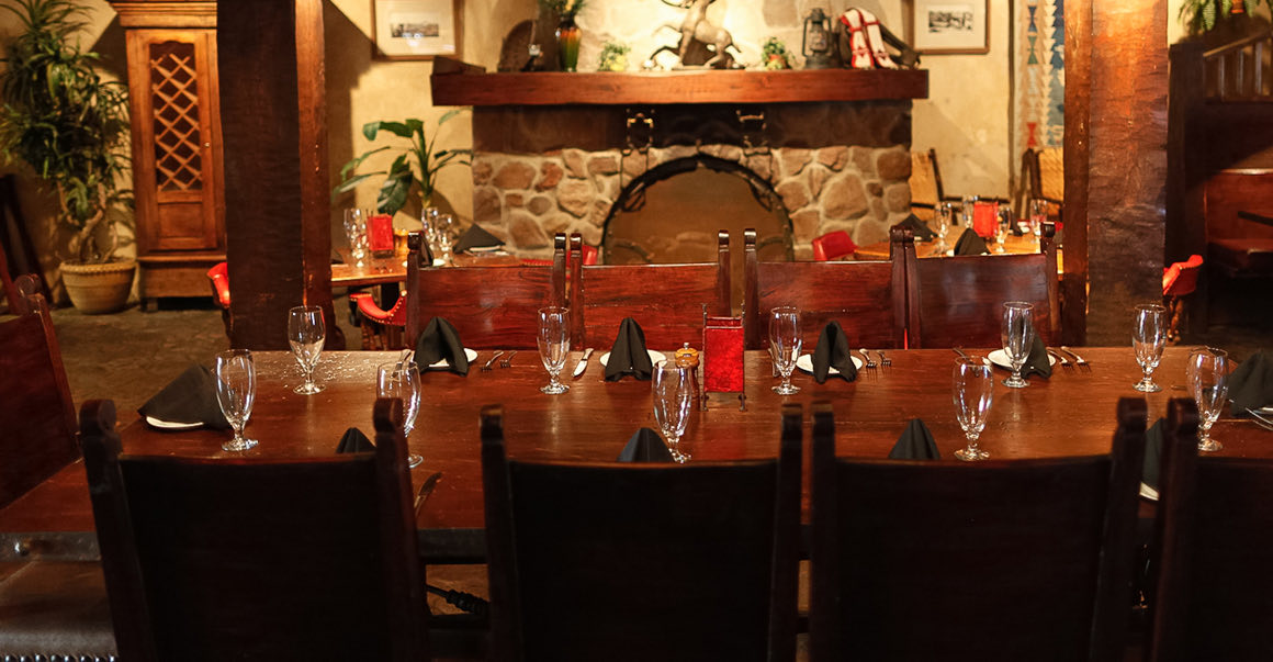table for ten people set inside restaurant