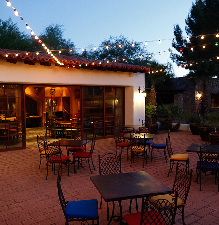 patio seating outside at night with string lights