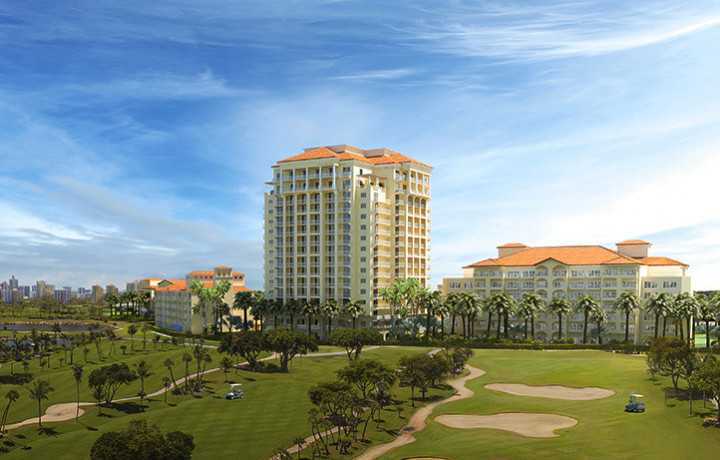 Aerial view of Turnberry building overlooking golf course with palm trees