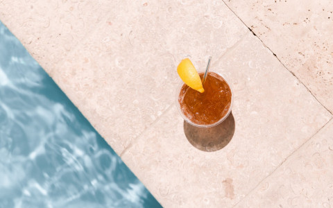 drink sitting at edge of pool