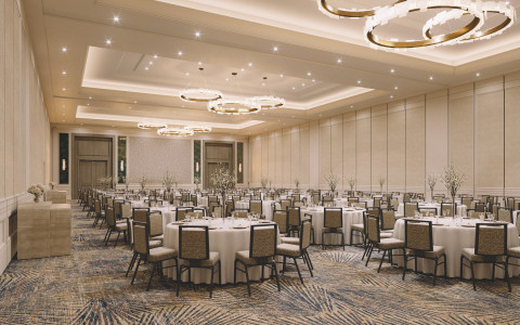 event room with tables set with center pieces