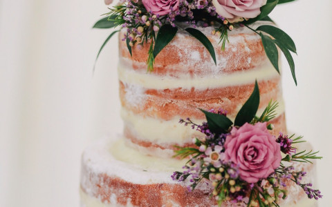 tiered wedding cake with pink flowers